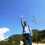 Soochna Sevak showing the height of the wires from ground level